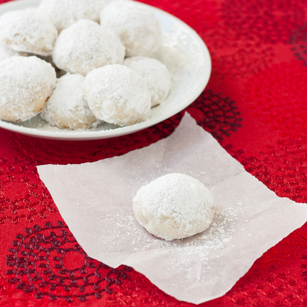 Butter Snowballs - soft, melt in your mouth cookies with a dusting of powdered sugar! The perfect holiday cookie! My family bakes these every year at Christmas.