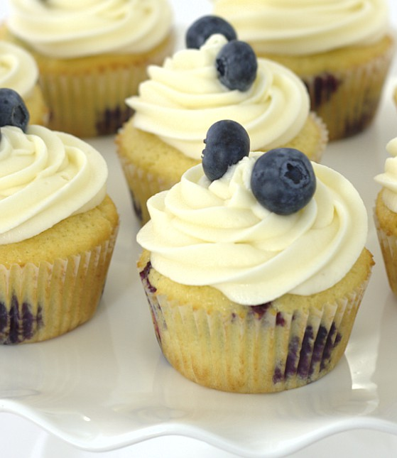 Fluffy cupcakes studded with blueberries and swirled  with a sweet, tangy cream cheese frosting. | Kristine's Kitchen