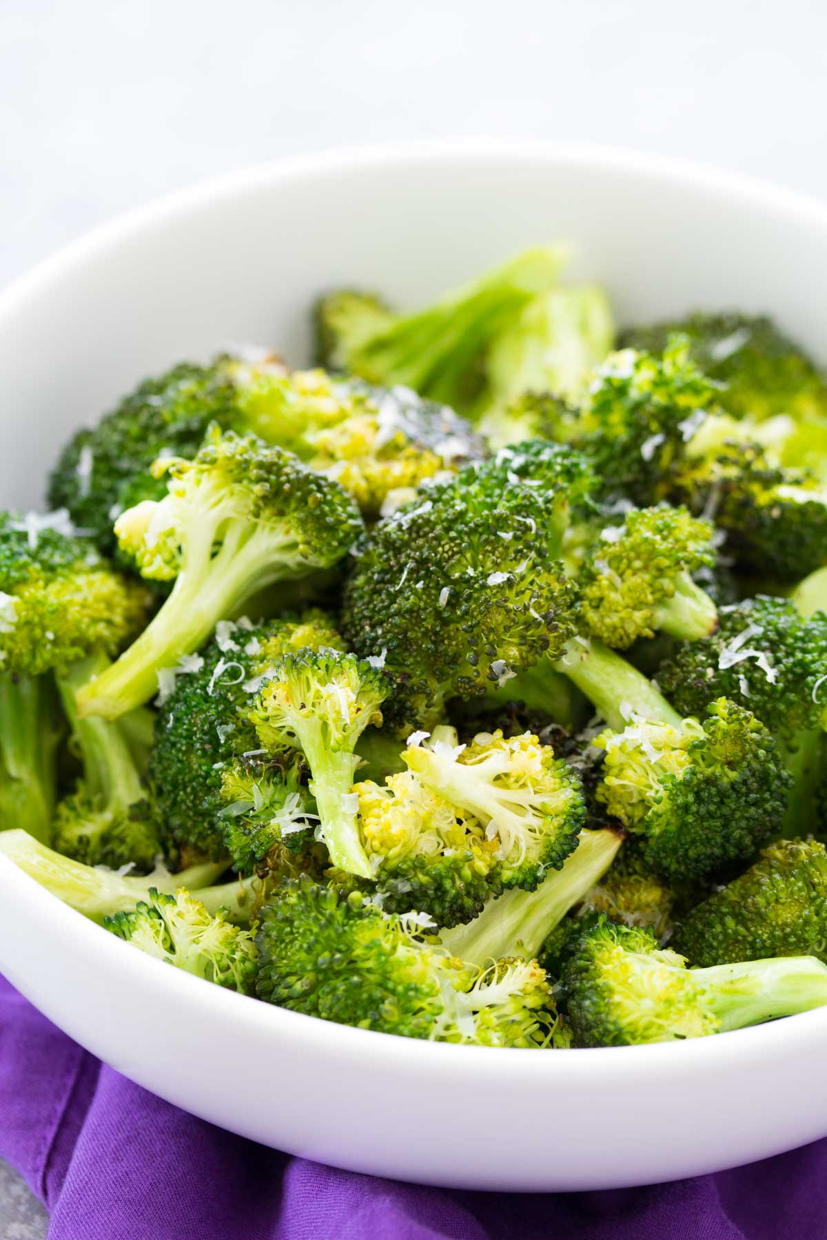 How to roast broccoli in your oven. An easy roasted broccoli recipe with garlic and Parmesan cheese options. A healthy side dish for any meal!