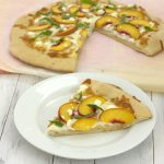 pizza with peaches, basil, and goat cheese