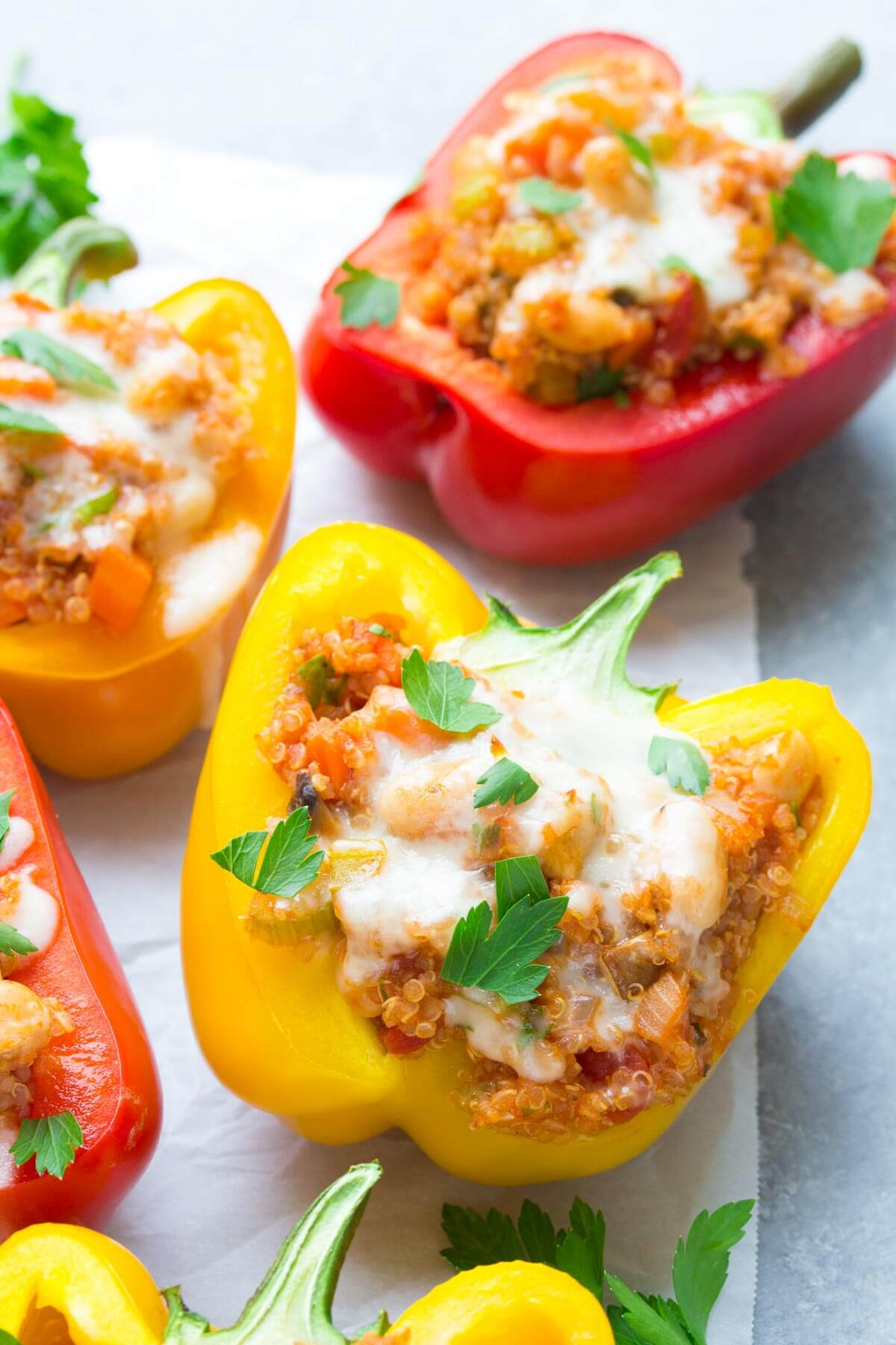 These cheesy Italian Quinoa Stuffed Peppers take stuffed peppers to a whole new level! They're a healthy, protein-packed vegetarian meal! | www.kristineskitchenblog.com