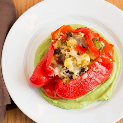 Stuffed Red Bell Peppers with Couscous and Avocado Sauce