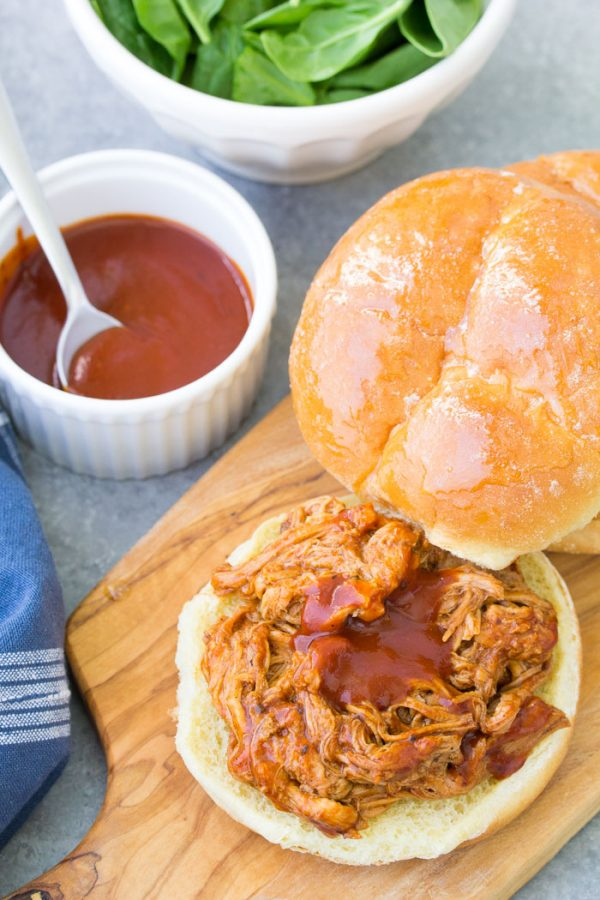 The best slow cooker BBQ pulled pork recipe! Tender and flavorful pulled pork is so easy to make in your crockpot. Make pulled pork sandwiches and use the leftovers in quesadillas, tacos or nachos. Perfect for easy meals on busy busy days or for a crowd.