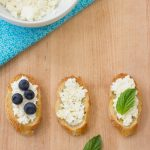 Rich homemade ricotta cheese makes a wonderful spread for crostini and is AMAZING with a drizzle of honey! | Kristine's Kitchen