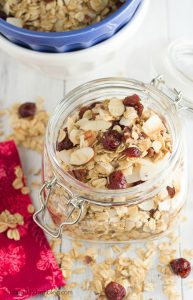 A lower sugar granola, filled with toasted nuts and coconut, you'll love this Cranberry Coconut Granola | Kristine's Kitchen