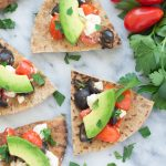Olive, Tomato and Feta Pita Crisps with Avocado - an easy appetizer that's completely addicting!