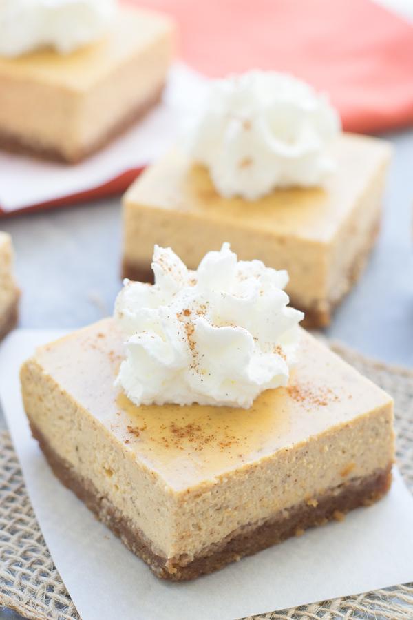Pumpkin Greek Yogurt Cheesecake Bars - You'll fall for these lighter, pumpkin spiced cheesecake bars!