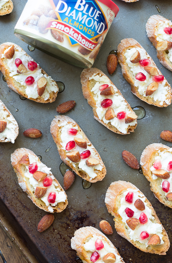 Smokehouse Almond, Goat Cheese, and Pomegranate Toasts - a delicious combination of sweet and smoky, creamy and crunchy! A perfect game day snack or holiday party appetizer!