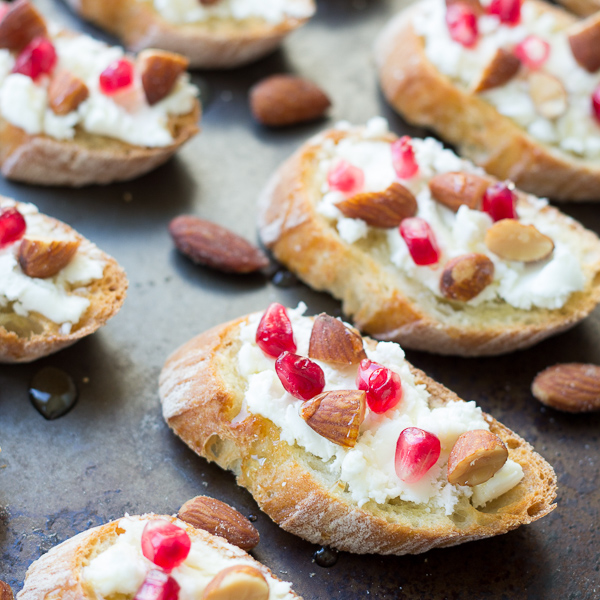 Smokehouse Almond, Goat Cheese, and Pomegranate Toasts
