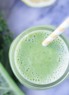 Our Favorite Green Smoothie starts with kale, frozen mango or peaches, and a little Greek yogurt. A squeeze of lemon juice makes this healthy drink so refreshing! It's a yummy healthy breakfast, lunch, or snack!