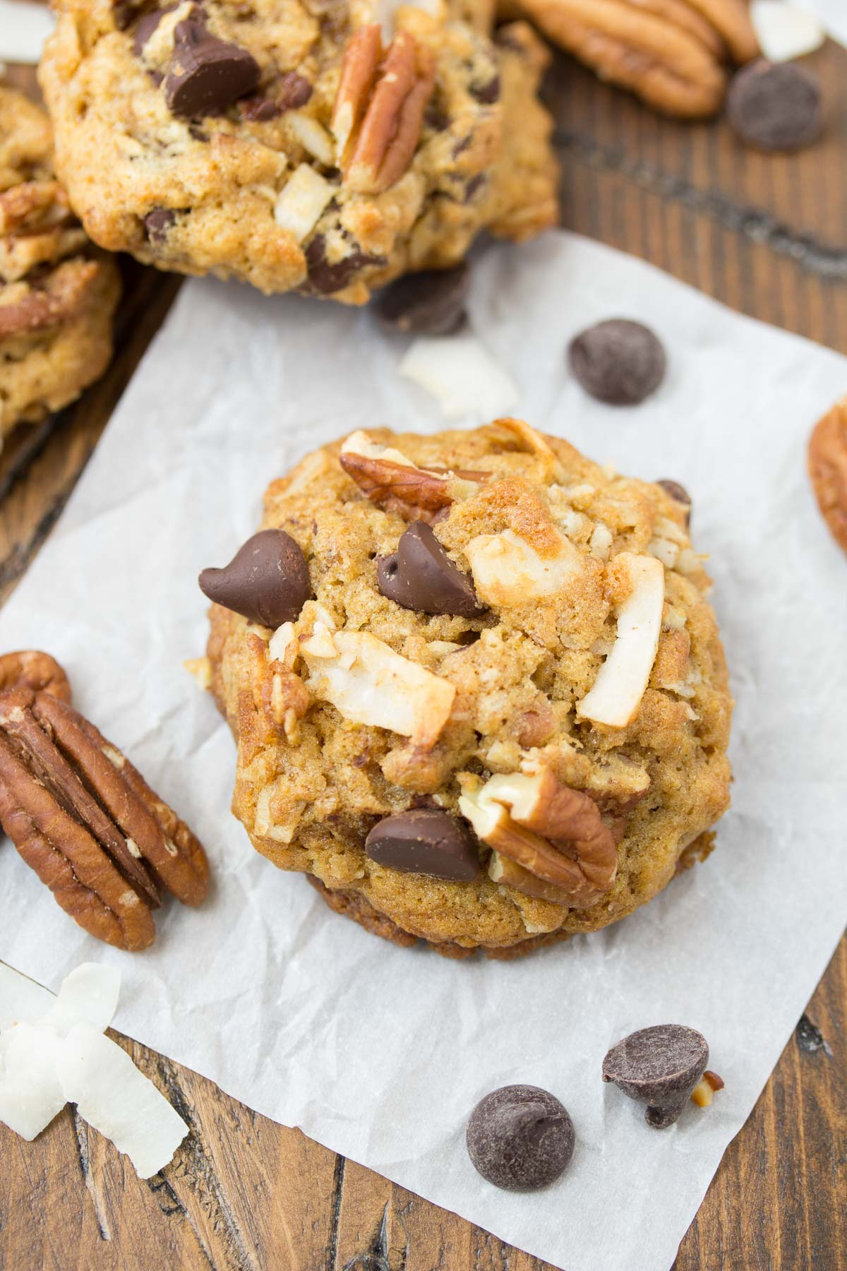 Soft and delicious Loaded Whole Wheat Chocolate Chip Cookies, made with wheat germ and 100% whole wheat flour! With toasted coconut, pecans, and oatmeal this healthier cookie recipe is the best!