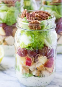How to make an easy and healthy mason jar salad for make-ahead lunches! These Chicken Salad Mason Jar Salads with grapes, apple, and toasted pecans have a creamy, no mayo poppy seed dressing!   www.kristineskitchenblog.com
