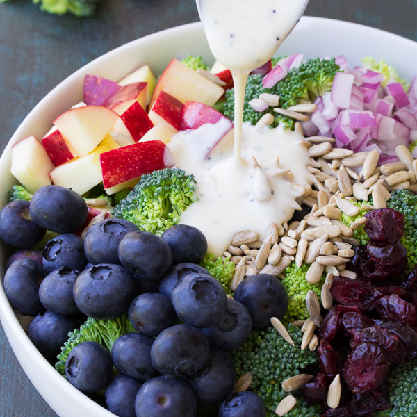 Best Ever No Mayo Broccoli Salad with Blueberries and Apple! This healthy and easy side dish has a creamy poppy seed dressing, cranberries, and sunflower seeds. It will be the hit of your summer BBQ or 4th of July party! www.kristineskitchenblog.com