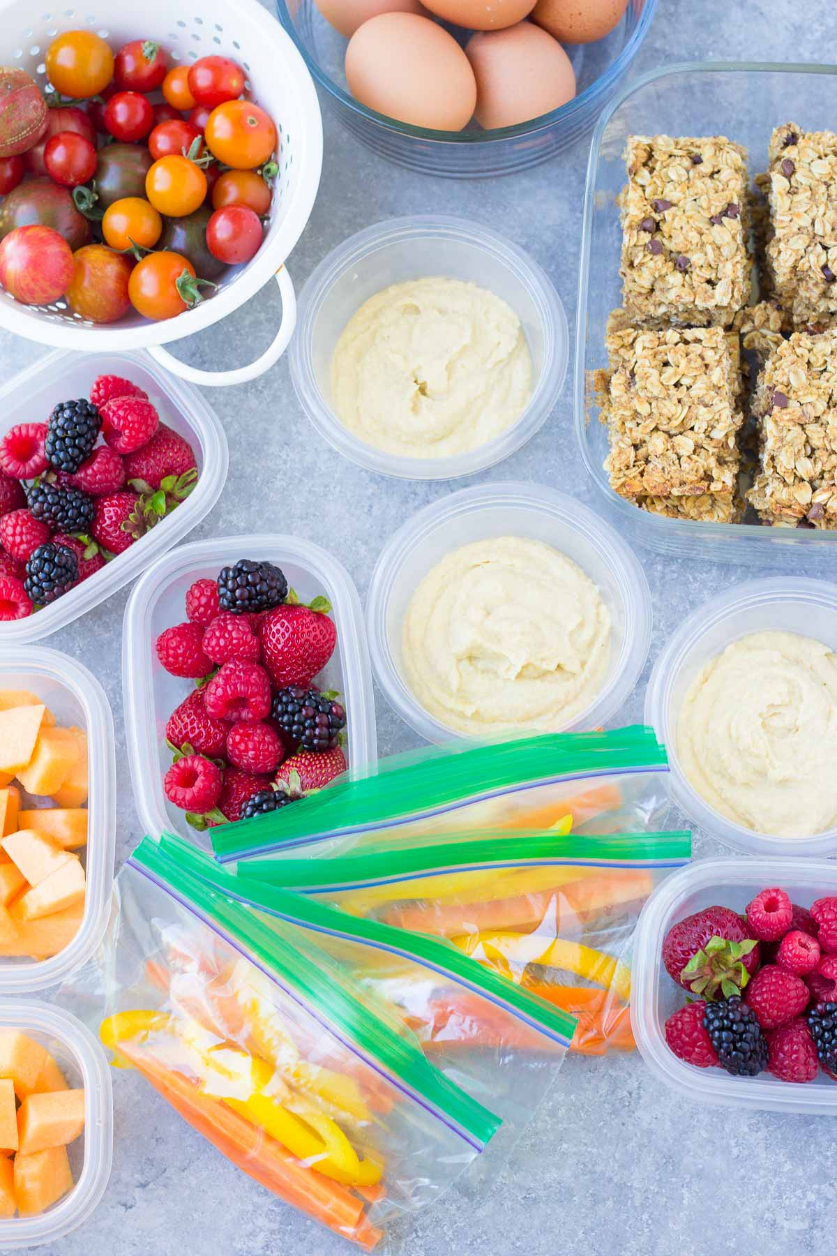 Tips and ideas for creating a snack station in your refrigerator, so that you always have healthy snacks ready to go. Plus, two printables to help make weekly snack prep so easy! Grab and go ideas for the kids for summer and after school. kristineskitchenblog.com