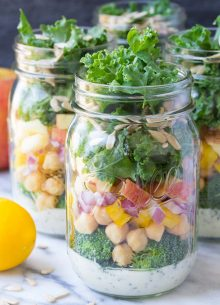 These easy vegetarian Mason Jar Broccoli Salads with Kale and Apple are a yummy make ahead lunch option! | www.kristineskitchenblog.com