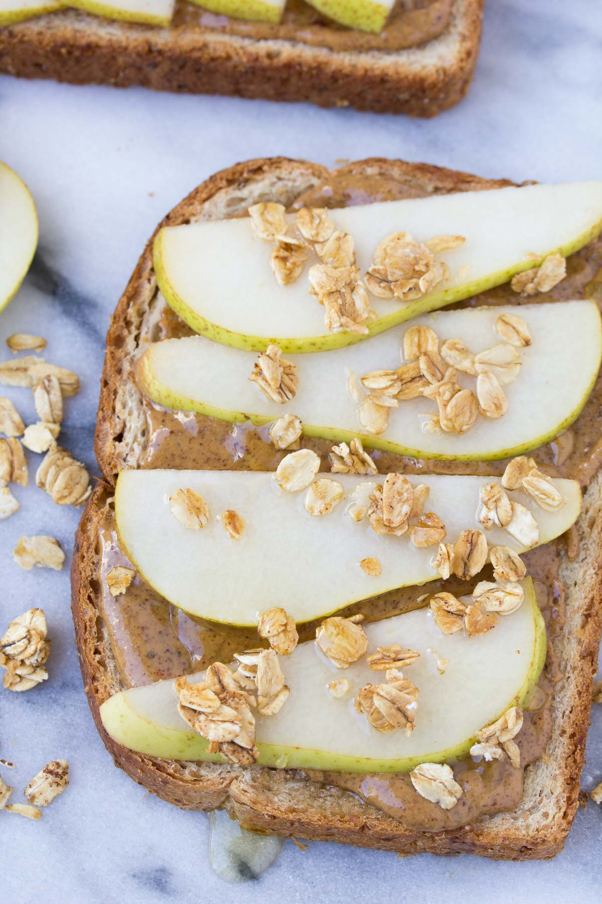 This healthy pear and almond butter toast with granola and honey makes an easy breakfast or snack! | www.kristineskitchenblog.com