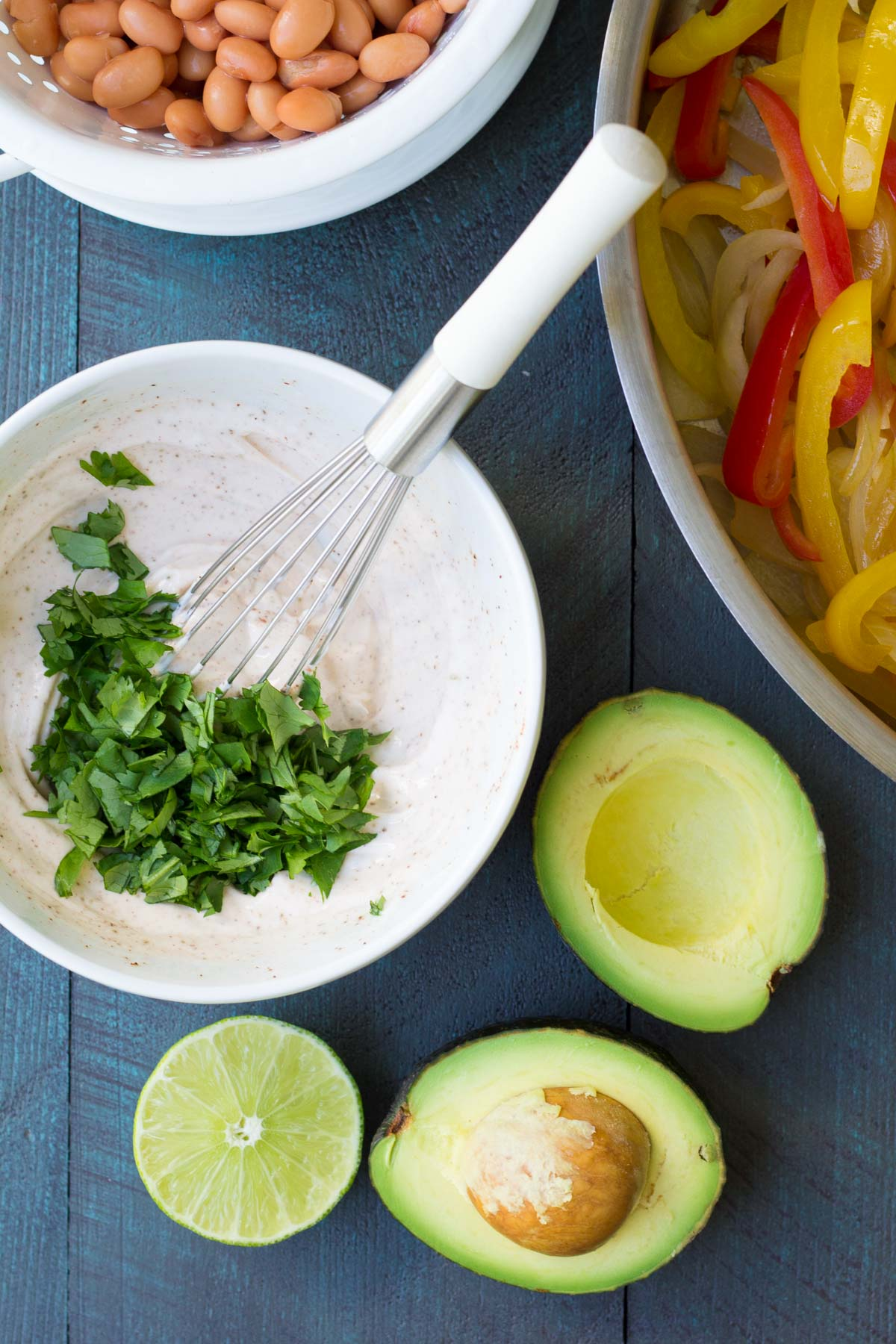 These Creamy Avocado Vegetable Burritos are a healthy 30 minute dinner recipe! | www.kristineskitchenblog.com