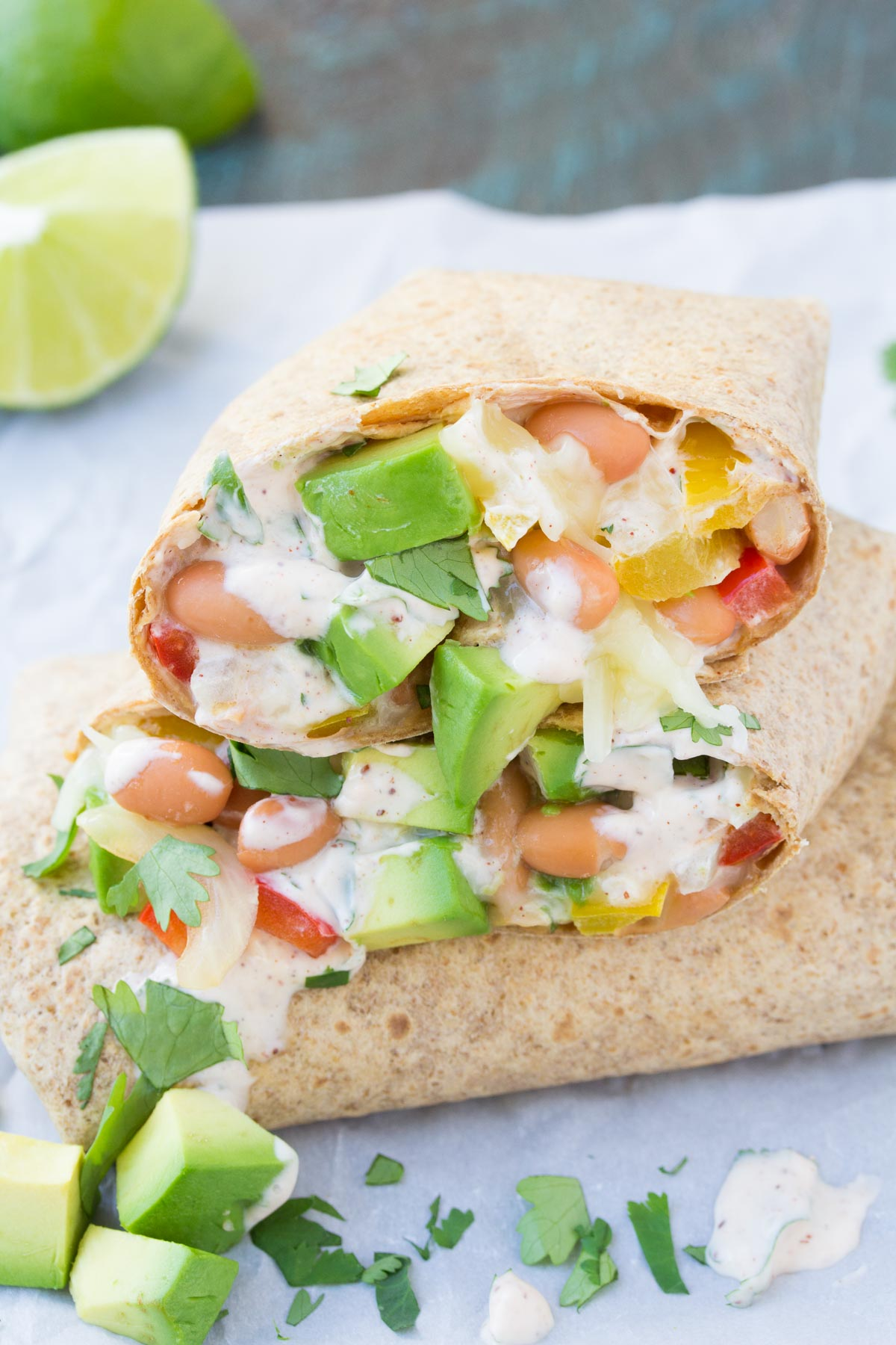 These Creamy Avocado Vegetable Burritos are a healthy 30 minute dinner recipe!   www.kristineskitchenblog.com