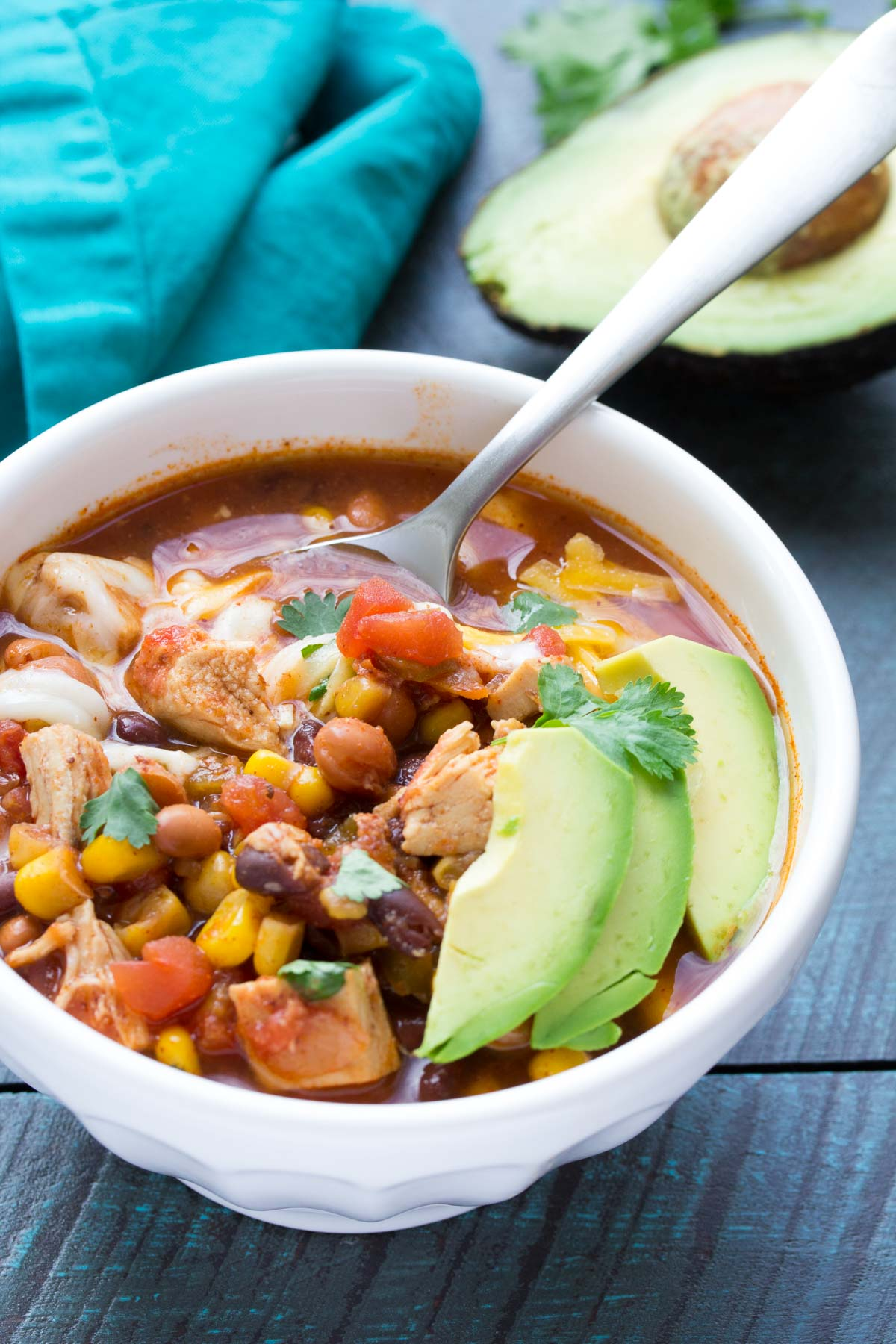 Dump and go (no chopping) easy slow cooker chicken taco soup recipe. A family favorite, made in your crock pot! | www.kristineskitchenblog.com