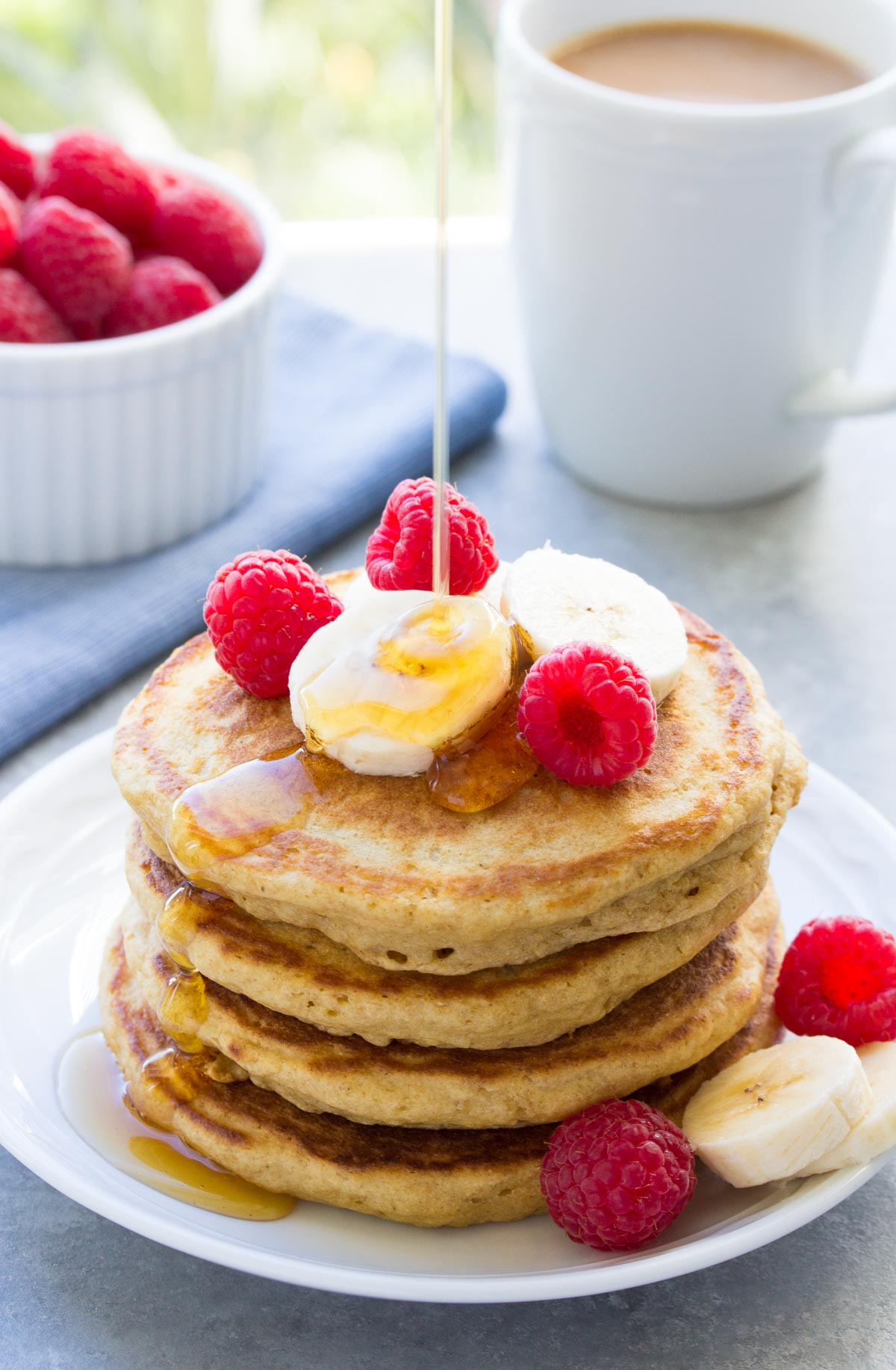 Tried and True Best Easy Healthy Pancake Recipe! This simple batter makes light and fluffy pancakes and delicious waffles, too! Made with honey, whole wheat and refined sugar free! | www.kristineskitchenblog.com