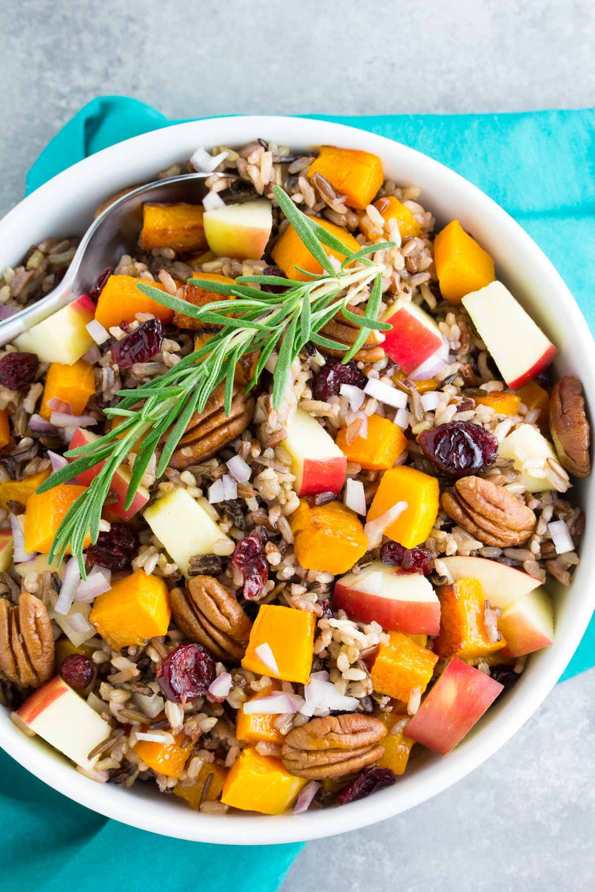 An easy, delicious holiday side dish or make ahead lunch. You will make this Roasted Butternut Squash Wild Rice Salad with Apple, Cranberries and apple cider dressing again and again! | www.kristineskitchenblog.com