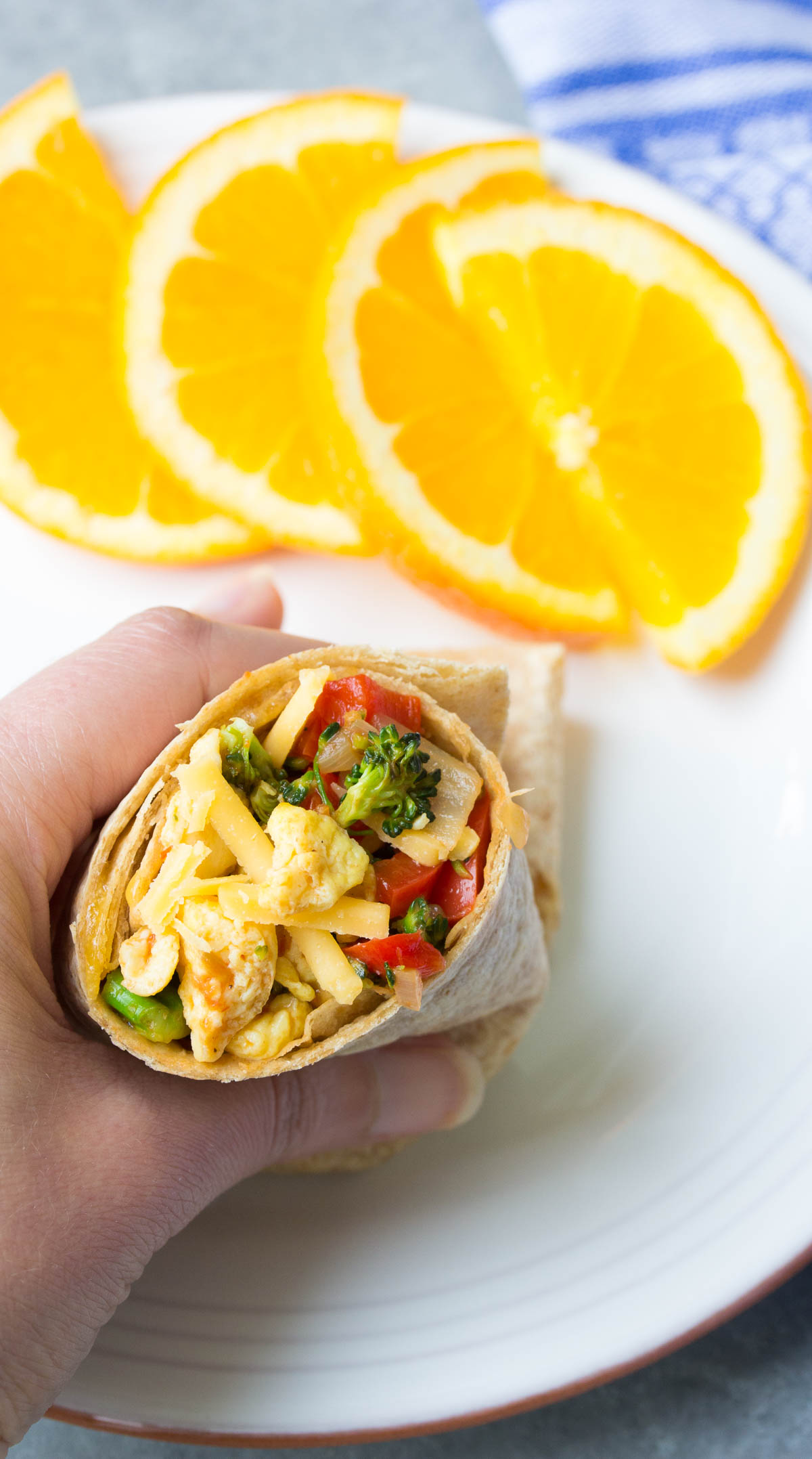 Healthy Freezer Vegetable Breakfast Burritos that you can make ahead and freeze for busy mornings. Easy meal prep burritos with broccoli, eggs and salsa!   www.kristineskitchenblog.com
