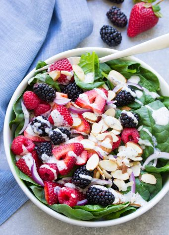 Triple Berry Spinach Salad with Creamy No Mayo Poppy Seed Dressing. A light and healthy vegetarian salad!