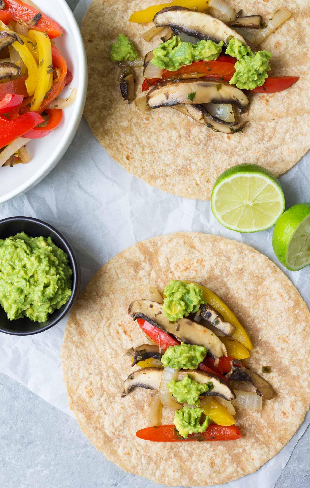 These Vegetarian Portobello Mushroom Fajitas are a 30 minute meal that you can prep ahead. With guacamole, these healthy vegan fajitas are hard to resist! | www.kristineskitchenblog.com