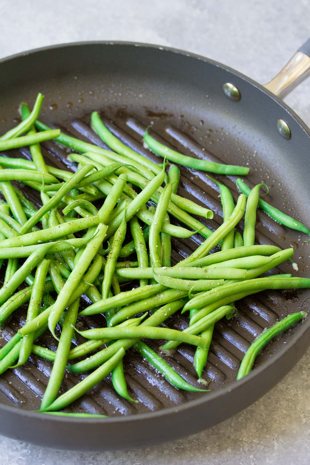 Crisp, fresh Skillet Parmesan Green Beans are an easy side dish that you'll want to make again and again! Only 3 ingredients in this healthy recipe! | www.kristineskitchenblog.com
