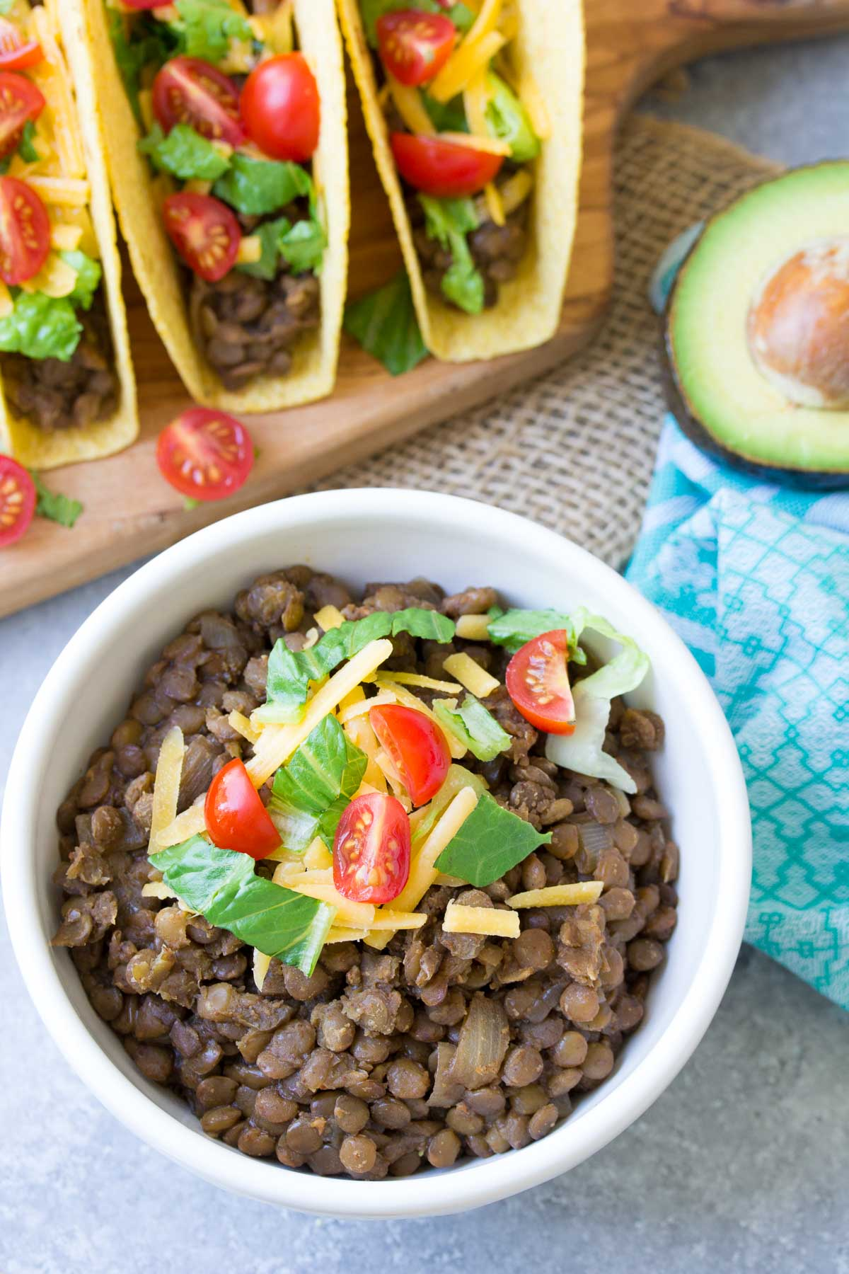 These Slow Cooker Lentil Tacos are easy to prepare and the filling is freezer-friendly. This healthy slow cooker vegetarian taco filling is also vegan (if you leave off the cheese). My family loves these crock pot tacos!