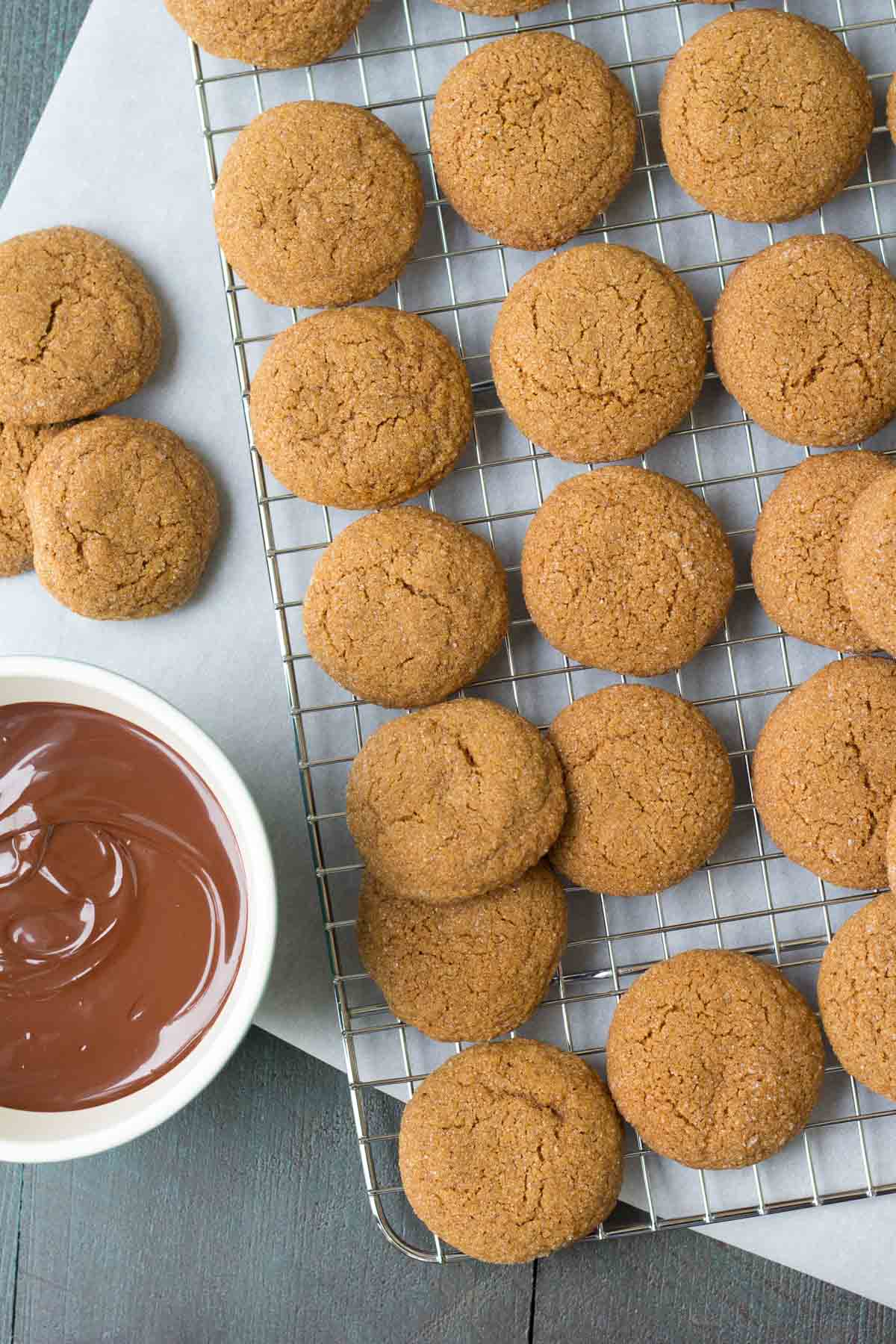 These soft and chewy molasses spice cookies are dipped in dark chocolate! They are a spiced Christmas cookie made with whole wheat flour and brown sugar.