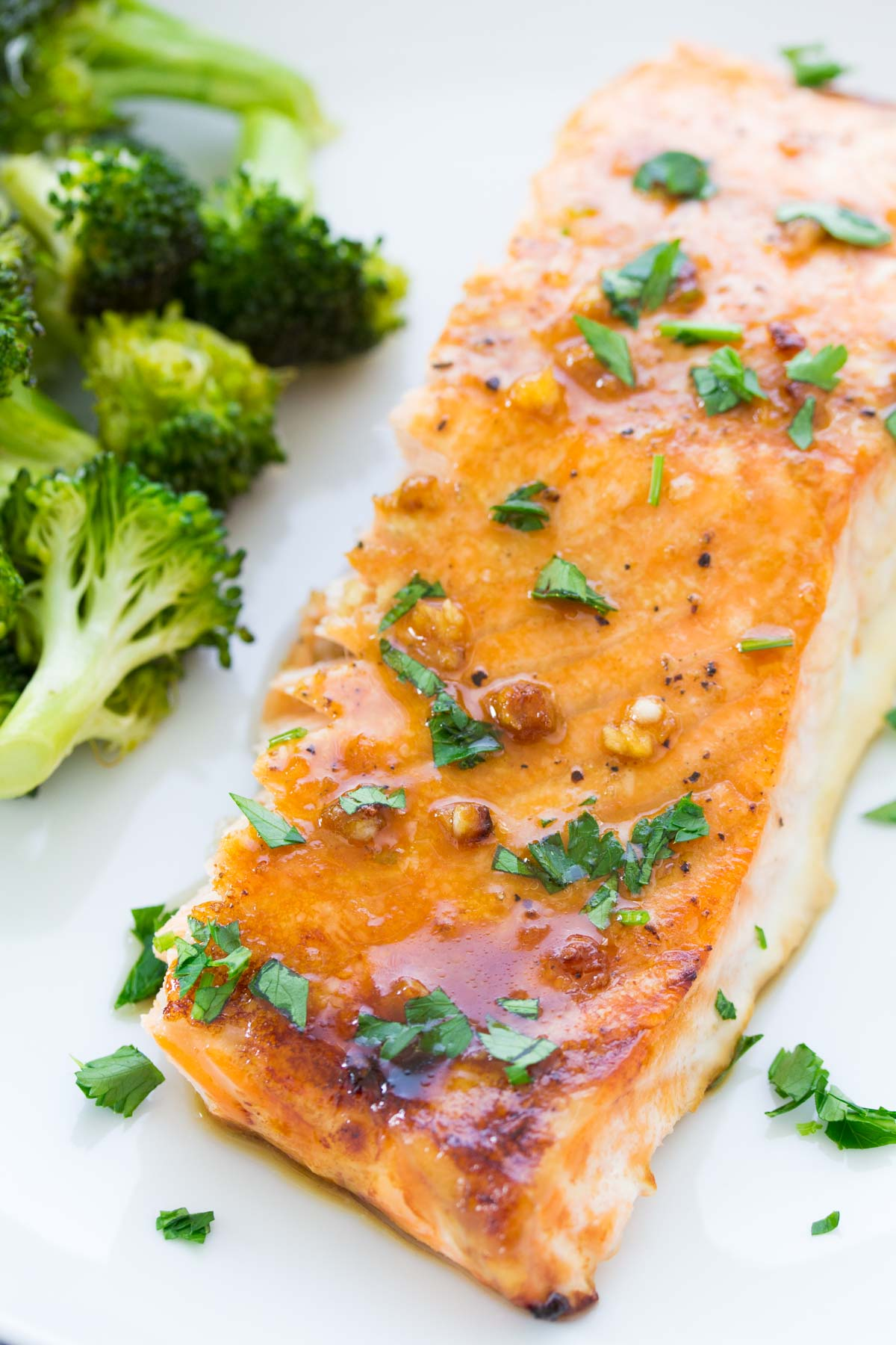 This easy oven baked salmon recipe is our favorite! With a honey, Dijon and garlic sauce and just 10 minutes of prep time this salmon is a 30 minute meal.