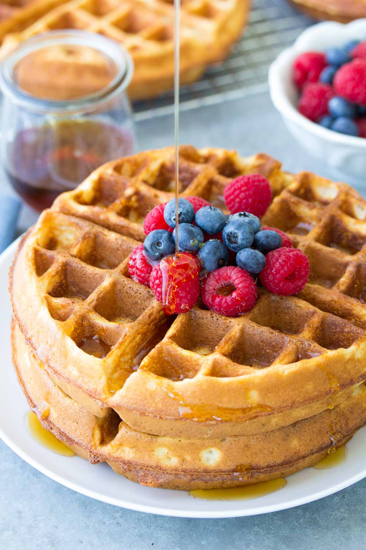 Light and crispy buttermilk waffles!! These healthier waffles take just 10 minutes prep! Store them in your freezer for easy meal prep breakfasts!