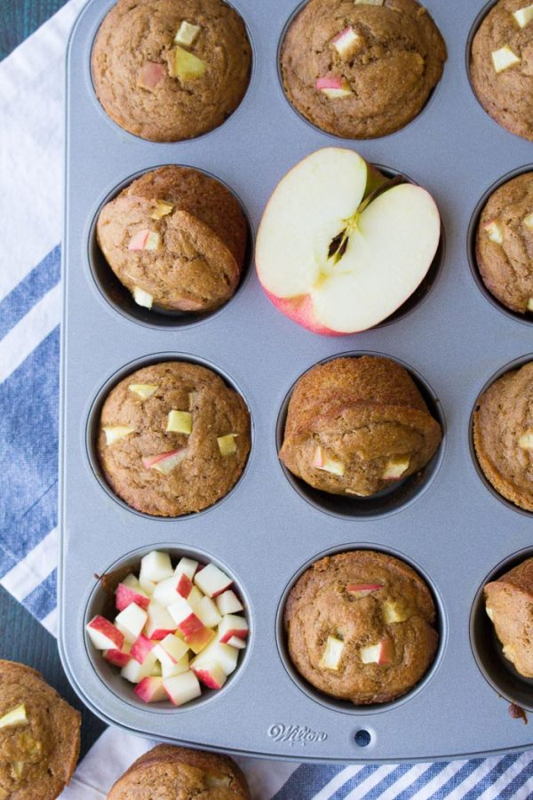 Healthy apple muffins in a muffin pan.