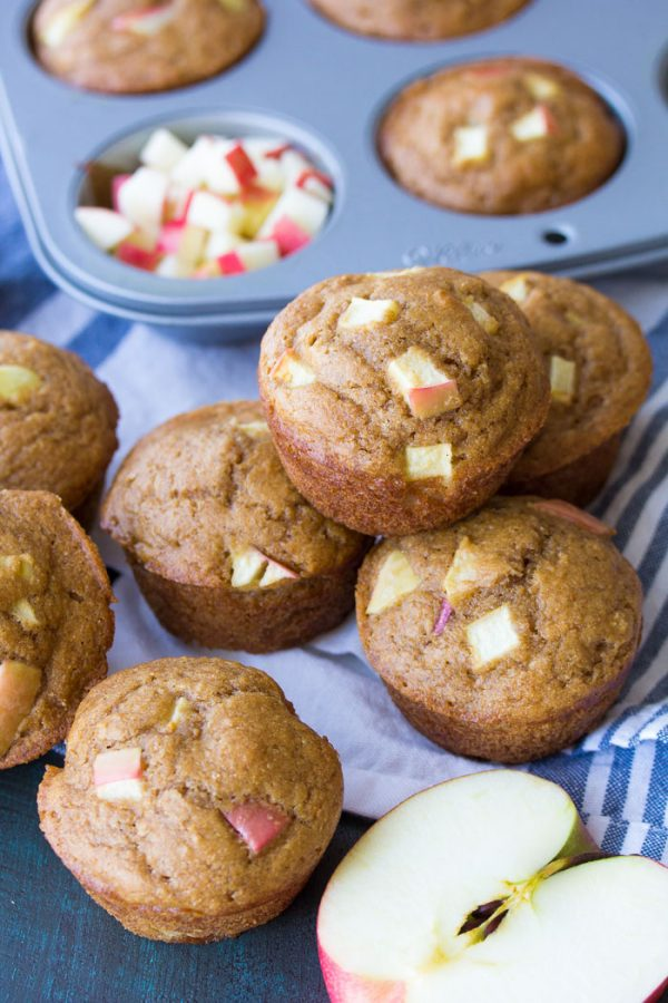 These healthy apple muffins are quick and easy to make in one bowl! This whole wheat muffins recipe is made with applesauce, fresh apples and cinnamon. Make a batch of these best apple muffins for your freezer this fall!