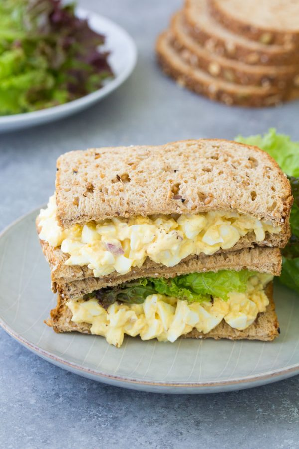 My easy egg salad recipe makes the best healthy egg salad. It starts with perfectly hard boiled eggs and a creamy dressing. Make a classic egg salad sandwich, serve egg salad on toast with avocado, or serve in lettuce wraps for a light meal. Use Greek yogurt for a no mayo egg salad.