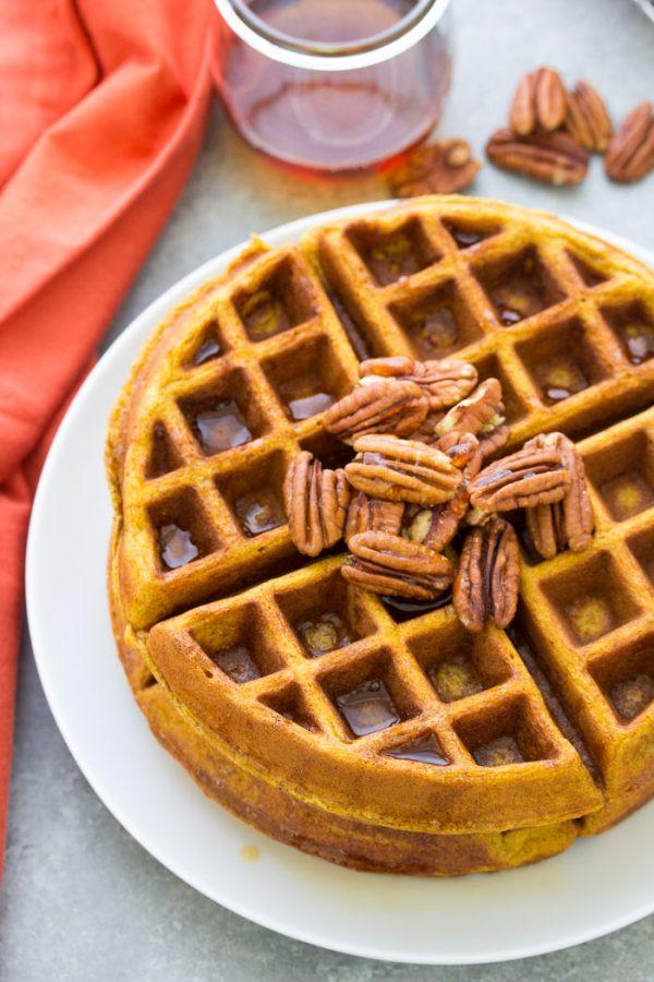 Whole wheat pumpkin waffles on a plate.