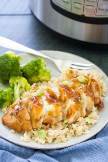 Honey Garlic Instant Pot Chicken Breast served over brown rice, with broccoli on the side.