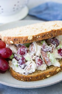 Chicken salad recipe with grapes in a sandwich.